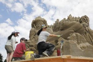 artist and sand sculpture