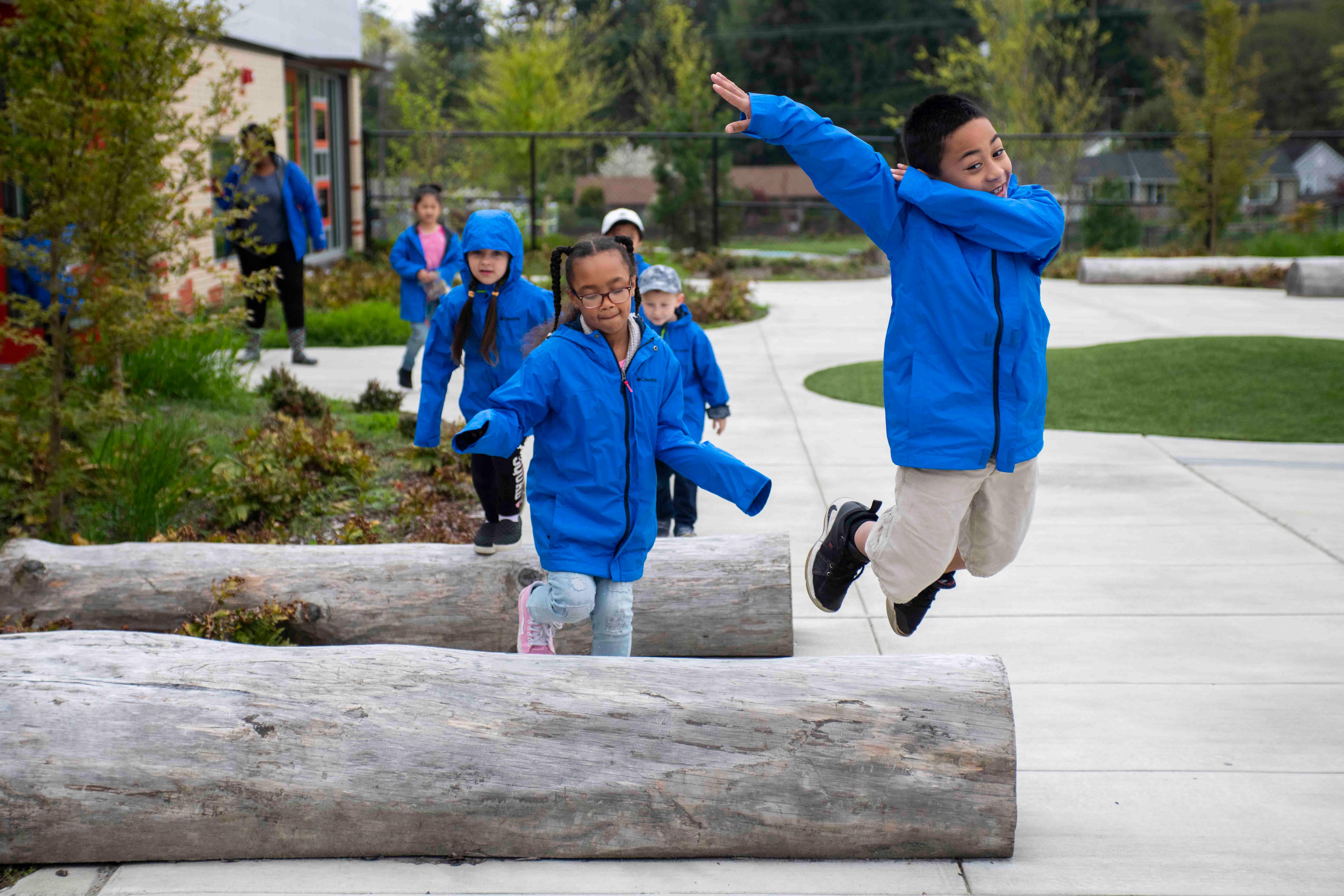 kid jumping logs