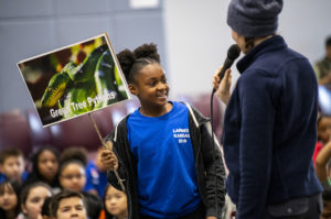 girl speaking at wildlife assembly
