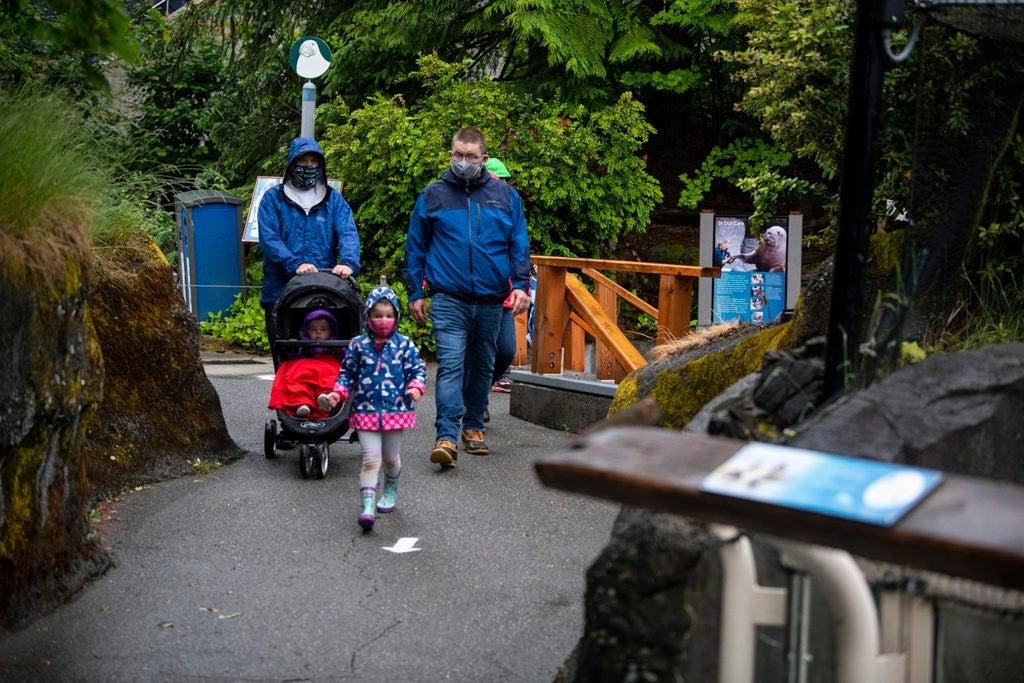 masked family walking