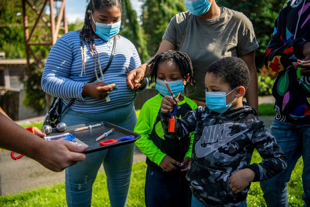 hero rat family holding syringes