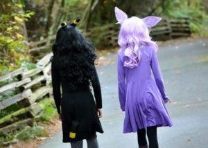 girls walking path costumes