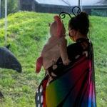 mom and kid in costume near tapir