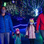 zoolights family holding hands