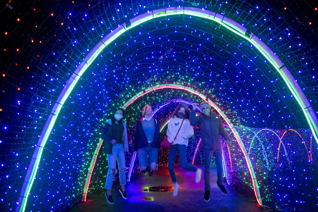 zoolights teens in tunnel jumping