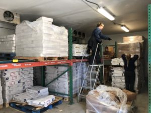 Unloading the seafood order to put into cold storage.